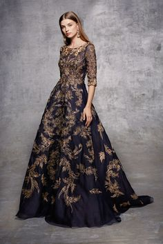 ¾ sleeve fully embroidered organza soft A-line gown with gold metallic outlined threadwork and rose gold bugle bead encrusted floral beading at neckline and cuffs.