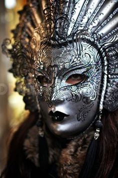 Venitian Carnival mask. I associate all masks with Trickster. I love the mystery and I love androgynous quality of them. This one is exquisite!