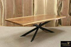 Black walnut natural-edge table with interesting welded-steel base, made by Jewell Hardwoods