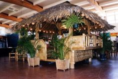 I would so put this in my backyard. Tiki hut from tropicalgardenfurniture.com
