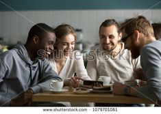 Millennial girl showing funny photos or videos on cellphone to multiracial young friends at cafe meeting, various happy friends laughing using mobile phone app together sitting at coffee house table Funny Picture Jokes, Funny Photos, Picture Video, Photo And Video, Friends Laughing, Photoshop, Happy Friends, Mobile Video, Children Images
