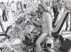 Amazing vintage chopper… and is that a matching viking (or spartan, haha) helmet she's holding?