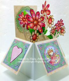 Created using papers/paper emblies from Crafter's companion Inspiration magazine & CD rom.