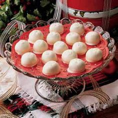"""Peanut Butter Snowballs""    These creamy treats are a nice change from the typical milk chocolate and peanut butter combination. This recipe is also an easy one for children to help with. I prepare them for a bake sale at my granddaughter's school and put them in gift boxes I share with neighbors at Christmas. -Wanda Regula, Birmingham, Michigan"