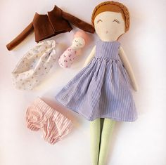 Kathleen and Dee are this sweet mother and baby set. They are perfectly suited as a baby wearing duo.  Kathleen is about 43 cms (17 in) tall. Her body is double lined and double stitched for durability. Her face is hand embroidered and therefore uniquely one of a kind. Her arms are button jointed. She comes with removable dress, bloomers, and sweater.  Dee comes with a sling for easy carrying. They are suggested for gentle play by children over 3. Adult supervision is recommended as they…