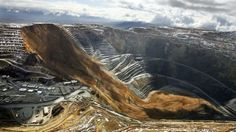 This April 11, 2013, file photo, shows the Kennecott Utah Copper Bingham Canyon Mine after a landslide in Bingham Canyon, Utah. The avalanc...