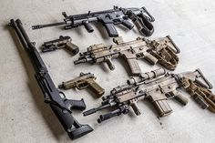 SCAR-H on bottom. SCAR-L on top. I think that the one in the middle is a SCAR-L. jdm