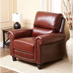 Sit in comfort, or lean back in feet-up comfort in the Abbyson Living Baron brown leather recliner. With foam cushion comfort, rich, supple leather upholstery, and attractive nailhead trim, this recliner may be the family's new favorite chair.