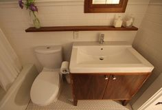 Bye Bathroom. Location: Portland, Oregon. This project involved the gut renovation of a tiny bathroom in a 1910 Craftsman bungalow. The design combined traditional Craftsman materials and detailing with modern accents.