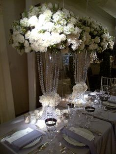 Tall white arrangement adorned by crystal strands