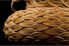 Hana Kago or flower arranging basket, woven of blond, leached bamboo and rattan in a treasure bag form with a loop style handle. Signed by the artist with an incised signature on the reverse: Rokansai Saku or Made by Rokansai (Iizuka Rokansai, the go or art name of Iizuka Yanosuke, 1890 – 1958). Showa era, circa 1936 – 1949. With the tomobako or original box, inscribed on the exterior of the lid: Hana Kago or Flower Basket; and on the reverse of the lid titled the piece: Hojyu or Buddhist…