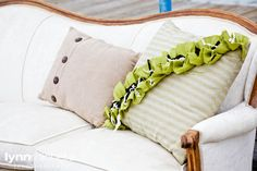 nautical chic, lime green, tan buttoned pillows, sitting area.
