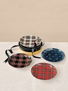 """Set of four porcelain plates for salads, desserts or hors d'oeuvres, each with a different tartan. Dishwasher and microwave safe. 8"""" diameter. Set of four.    { more information }  $52.00"""