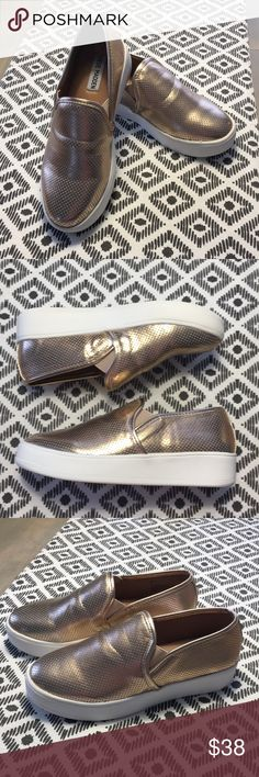 Steve Madden Platform Slip On Sneakers - NWOT - 7 You can never go wrong with the Gracy sneaker. PU upper and lining. Beautiful rose gold color. Slip-on construction. Perforated detail throughout. Synthetic lining. Lightly padded footbed. Rubber outsole. Imported. Steve Madden Shoes Sneakers