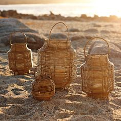 Woven rattan lanterns made from natural arurog. Has internal hurricane glass sleeve for outdoor use.
