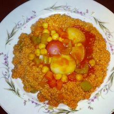 A beautiful traditional Mediterranean dish. Couscous and veggies and it's 100%	vegetarian!