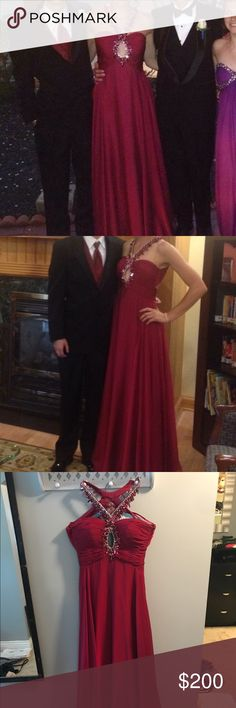 Burgundy full length prom dress Burgundy/maroon colored full length prom dress. Criss-cross design in both front chest and back area, beads around chest, hole in cleavage area for design. Morrell Maxie Dresses Prom