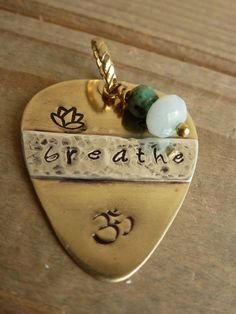 Hand Stamped Necklace.Guitar pick necklace. Ohm Necklace. Breathe necklace. Yoga necklace by LittleHJewellery on Etsy
