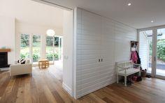 hidden wall storage . panels . wodden floor .