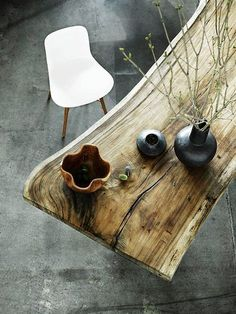 Consider the raw edged table.  Even paired with acrylic chairs, this table is a conversation piece. BellaRusticaDesign.com