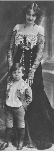Edwardian Era. Look at that dress~ and the little boy. Love his expression!