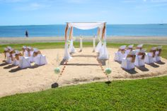 A beautiful beach themed gazebo setup with latte sashes to match the vau and starfish at the Hilton Resort