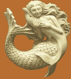carved mermaid and dolphin sculpture