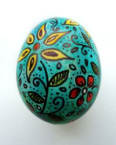 Sharpie doodle then painted with food coloring. Easter egg.