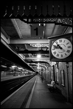 Passing time by Ally Mac ~ An 8 minute exposure of a train arriving and departing at Newark North Gate Station.