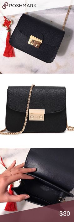 Black mini messenger bag with gold chain & button Super fun mini messenger bag 💼 new with no tags!  Comes with cute fun red Chinese style tassel. Material:Polyester Hardness:Hard Shape: Flap Decoration: Button, Chains Interior: Interior Slot Pocket Main Material:PU Type:Messenger Bags Bags Crossbody Bags