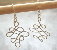 Items similar to Sterling Silver Celtic Knot Dangle Earrings, or Gold Celtic Knot Dangle Earrings on Etsy Long Silver Earrings, Sterling Silver Earrings, Dangle Earrings, Gold Necklace, Celtic Knot, Dangles, Trending Outfits, My Style, Unique Jewelry