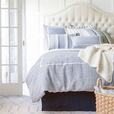 Keaton Linen Indigo Duvet Cover  $426.00 - $552.00 In a classic indigo and ivory combo, this linen chambray duvet cover, featuring a single pleat, is an easy, preppy piece with timeless appeal. Crafted to be an exact color match to our Hampton Ticking Linen Indigo duvet cover, shams, and decorative pillows. • 100% linen chambray. • Knife edge. • Hidden button closure.
