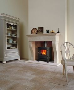 Nenaghgal: On the Search for a Wood Burning Stove -Chesneys, Charnwood - Wood Burning Fireplace Inserts Home Fireplace, Faux Fireplace, Fireplace Surrounds, Fireplace Design, Fireplace Ideas, Mantle Ideas, Stone Mantel, Limestone Fireplace