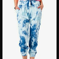 Joggers Never been worn These joggers are cropped not full length They have a tie in the front and a zipper at the side Cuffs at the bottom The third pic shows a little bright blue spot this is NOT a stain, this is the way the pants is made, these spots are at different places throughout the pants. Forever 21 Pants Track Pants & Joggers