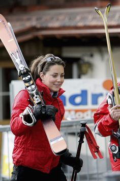 When in  Switzerland, do as the Swiss do.  Kate Middleton hits the powder in a red ski  jacket and sports accessories made for a successful day in Klosters.  Getty / Tim Graham / Contributor  - TownandCountryMag.com