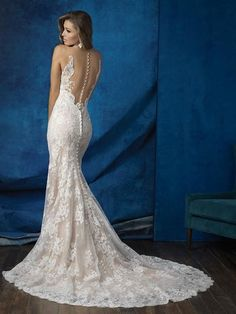 Allure 9253_This trailing lace gown features an illusion back framed by Swarovski crystal details and lace edging._