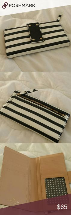 Kate Spade wallet Lovely patent leather black and white striped Kate Spade wallet zipper on the back plenty of room inside for your credit cards and ID also cash Excellent  condition kate spade Bags Wallets