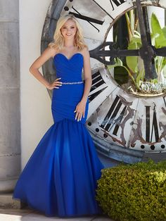 STYLE: 16-354  Emphasize your curves in this ruched gown, accented at the waist with a jeweled belt.