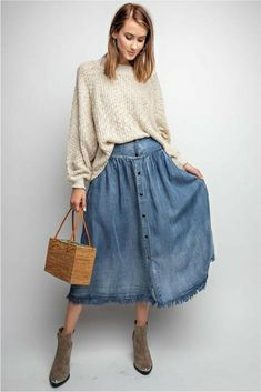 049de96625 Start your new fall fashion wardrobe with this denim midi skirt!  #fallfashion #modestfashion