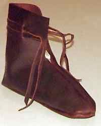 The shoe shown to the left is a copy of one found in Hedeby. The seam that joins the upper is in the center, rather than on the side, as with the York shoe, above. This pattern is much simpler to construct.