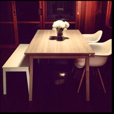 White Ikea Bench Seat Light Oak Table And Eames Replica Chairs Against