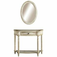 """A perfect addition to your master suite or bathroom, this charming 1-drawer wood console table showcases a matching wall mirror and weathered finish.  Product: Console table and mirror    Construction Material: Wood and mirrored glass    Color: Antique white  Features: Will enhance any spaceConsole table has one drawer    Dimensions:  Table: 30.75"""" H x 36.5"""" W x 12"""" D  Mirror:  28"""" H x 20"""" W x 1.25"""" D"""