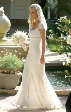 Tori Spelling married playwright Charlie Shanian in a million dollar ceremony July 2004. She wore a Badgley Mischka gown. Flapper-inspired, full-length, white gown adorned with intricate bead work and a diamond encrusted flower patterned headband attached to a veil.  They separated in October 2005 after Tori cheated with her film co-star Dean McDermott.  She and Dean were married on May 7, 2007.