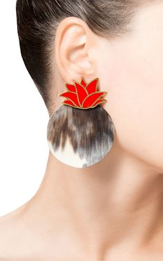 These handmade **Silhouette** earrings put a modern spin on traditional Georgian materials such as horn, with a dramatic pineapple shape and colorful leaf detailing.
