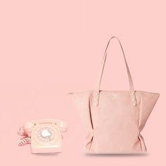 Recall the olden telephone with a finger wheel dial? This soft material #totebag designed with button studs has been inspired by this vintage instrument. #Baggit #Inspiration