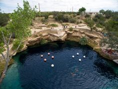 Santa Rosa Blue Hole, New Mexico An 80-foot deep crystal clear blue spring fed swimming hole and diving mecca, Santa Rosa Blue Hole is suprisingly located off Route 66, among the arid desert landscapes two hours east of Albuquerque.