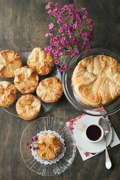 Kouign Amann 1 cup water, room temperature 2 tsps active dry yeast 2 3/4 cup all-purpose flour 1 tsp salt 8 oz. SALTED butter, cold 1 1/2 cup sugar extra butter for greasing the molds or tins extra sugar
