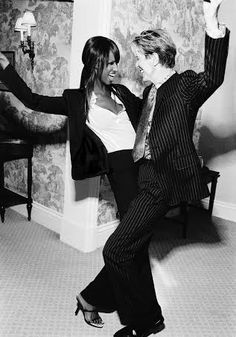 David Bowie and his wife Iman......love this photo of them both, they truly loved one another and it shows from all the photo's taken of them both together.