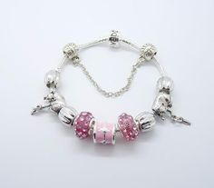 Pandora Bracelet- i love the pink and silver idea but I'd like other colors too.