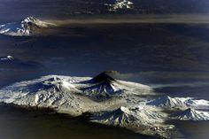 Volcanoes of Kamchatka from the ISS. The one that is smoking is Klyuchevskaya Sopka.